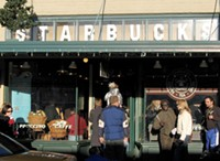 "The original Starbucks in Seattle, WA. - USER ""POSTDLF,"" WIKIMEDIA COMMONS"