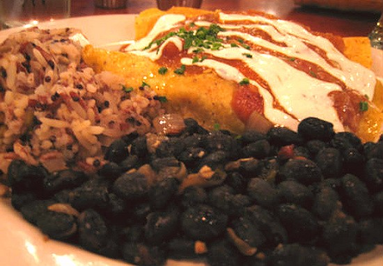 "The veggie enchiladas with meat-free Match ""chicken"" and cheese served with black beans, green chili sauce and rice. - REASE KIRCHNER"