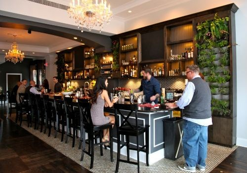 The bar, complete with live ferns at Blood and Sand - BETH FARROW CLAUSS