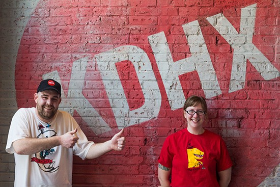 Magnolia Cafe staff, Brad Bufford and Allison Wilson, show off their KDHX swag.
