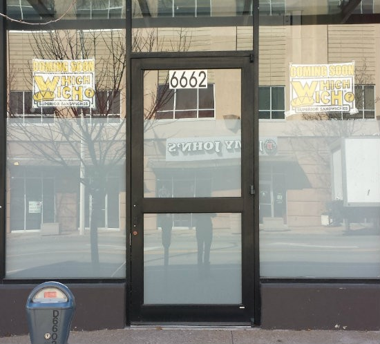 Why, yes, that IS a Jimmy John's sign reflected in the Which Wich's new storefront windows. | Jessica Lussenhop
