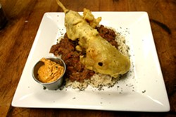 The andouille corndog with red beans and rice at Lola - CHRISSY WILMES