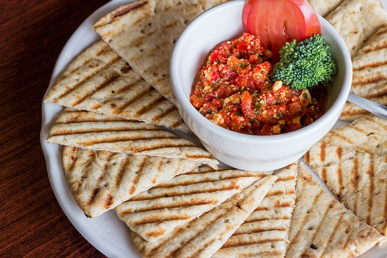 Roasted red pepper feta dip with toasted pita bread.