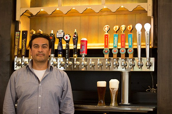 Owner Hugo Perez behind the bar.