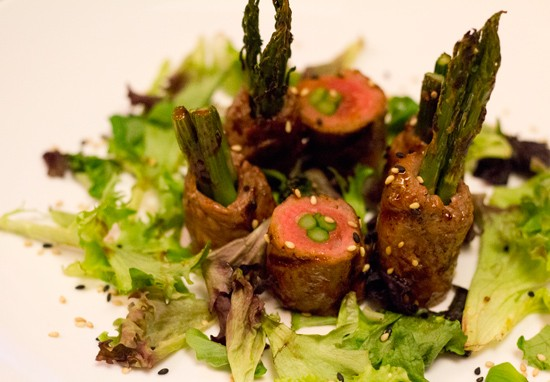 Gyu-Negima: Asparagus rolled in thin slices of premium beef, grilled and infused with a sweet garlic soy