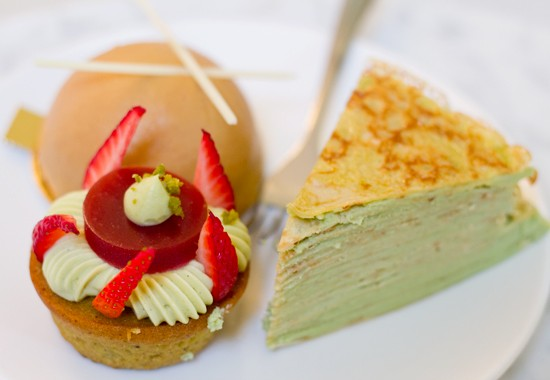 """Clockwise from bottom left: The """"Ooh La La"""" ($4.50) strawberry-pistachio tart, a """"Bananas Foster Bombe"""" ($5) and a """"Mille Crepe"""" ($4.25) flavored with white chocolate and Matcha. - MABEL SUEN"""
