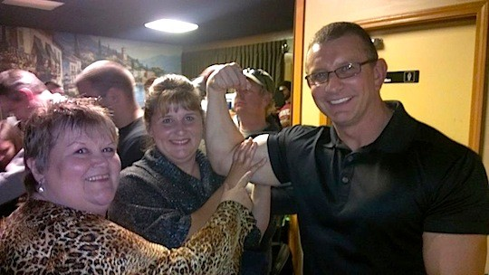 Diane Emery and Robin Beard Gordon of Caseyville Cafe check out Robert Irvine's muscles. - IMAGE VIA
