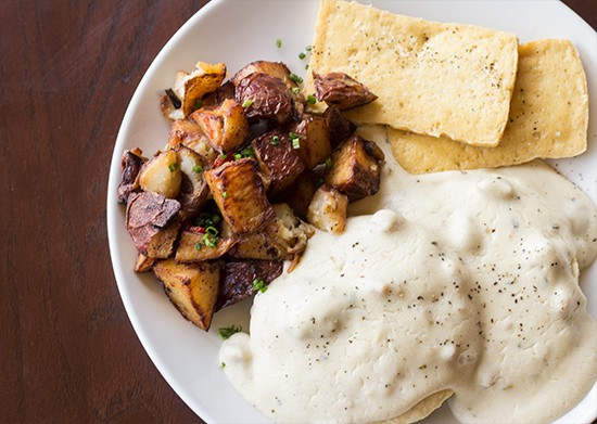 Biscuits and gravy plate: a country biscuit with sausage gravy, tofu and breakfast potatoes.