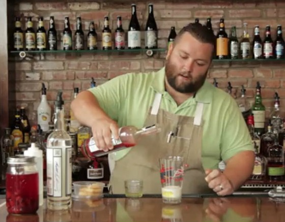 Chef Rick Lewis behind the bar with his infused moonshine.