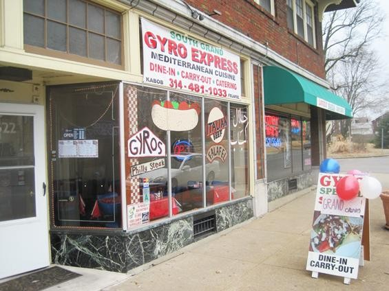 Colorful new graphics adorn the front window of the reopened South Grand Gyro Express. - IAN FROEB