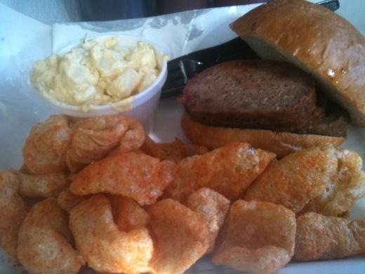 Sausage Fatty sandwich with deviled egg potato salad and BBQ pork skins. - ROBIN WHEELER