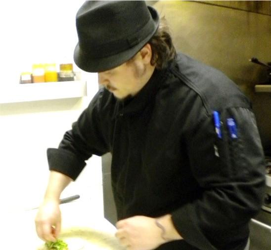 Matt Dawson prepares duck tacos. - DEBORAH HYLAND