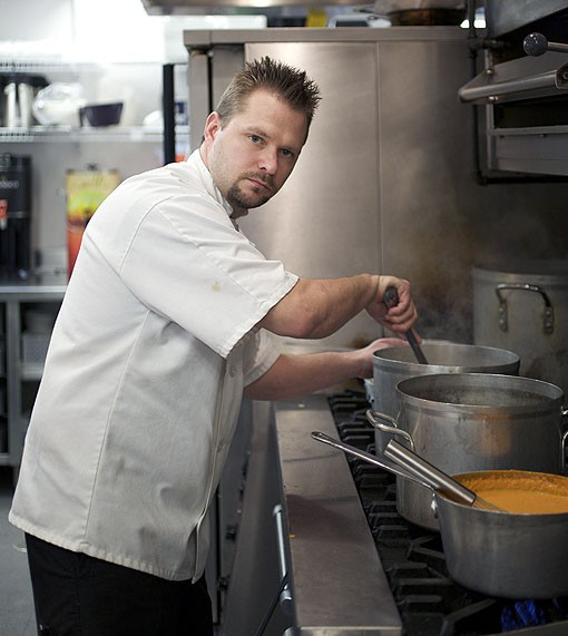 Executive Chef John Buchanan checking on his soups and sauces before the evening crowd arrives. See a slideshow of Table Three photos here. - PHOTO: JENNIFER SILVERBERG