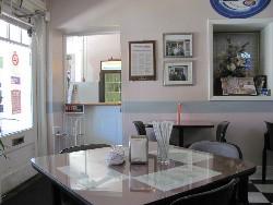 The homey table setting at Bahn Mi So #1. - ANTONIO PACHECO
