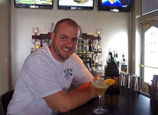 Sanctuaria bar manager Matt Seiter serves cocktails from his book tonight at Taste. - ALISSA NELSON
