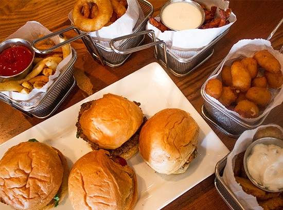 The happy-hour spread at Five Star Burgers. | Photos by Mabel Suen