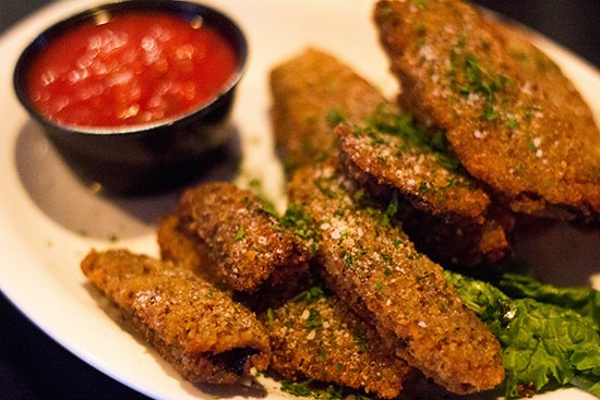 Breaded portabella mushroom wedges with marinara.
