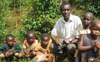 Coffee farmer Sam Kauka with his children. - COURTESY CROP TO CUP