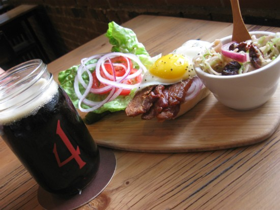 """4 Hands Cast Iron Oatmeal Brown beer paired with the Fifth Wheel's """"Spicy BLT""""  and a side of poached cherry slaw. - ALICE TELIOS"""