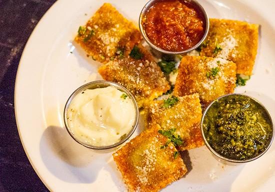 Toasted ravioli with aioli, pesto and arrabiata sauces. - PHOTOS BY MABEL SUEN