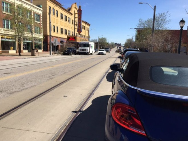 This 2016 photo shows just how close the tracks are to the parked cars on the eastern edge of the Loop. - SARAH FENSKE