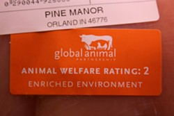 Close-up of a step-rating label on a package of Whole Foods chicken. - CHRISSY WILMES