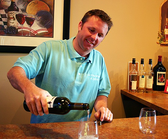 Cory Blackwell, owner/janitor of deVine Wines & Spirits, also has a good pour. - KATIE MOULTON