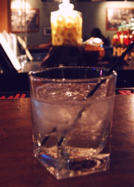 Housemade pineapple-infused vodka served on the rocks at the Side Bar. - CAILLIN MURRAY