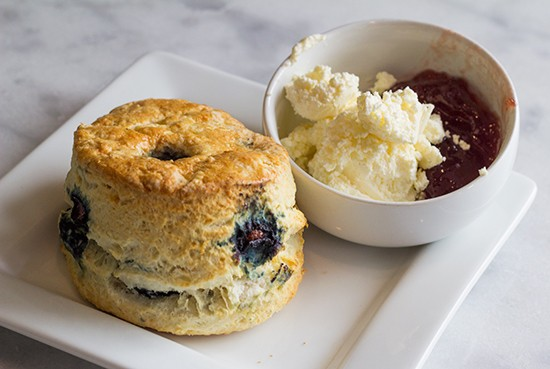 A blueberry scone with clotted cream and jam. - PHOTOS BY MABEL SUEN