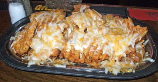 Mmmmmmm! Cheese fries! - KRISTEN KLEMPERT