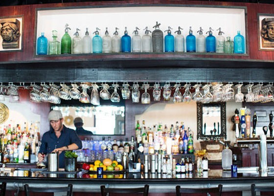 Co-owner Terry Oliver behind the bar at Tripel.   Jennifer Silverberg