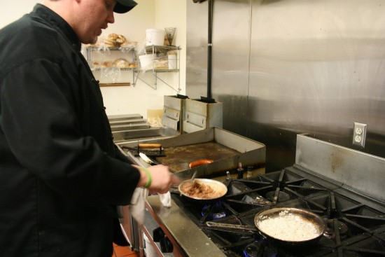Mike Ryan preparing red beans and rice - CHRISSY WILMES