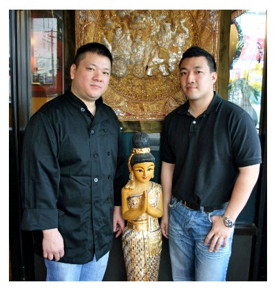 Scott (left) and Tommy Truong in the entryway of their restaurant, Pearl Cafe in Florissant. - CHRISSY WILMES