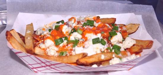 Hot and spicy loaded hand-cut fries at the Shack Pubgrub. - TARA MAHADEVAN