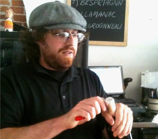 Stettner opens a bottle of wine - ANTONIO PACHECO