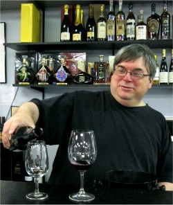 Dave Davis, assistant manager at the Wine Merchant and self-proclaimed Francophile - ERIKA MILLER