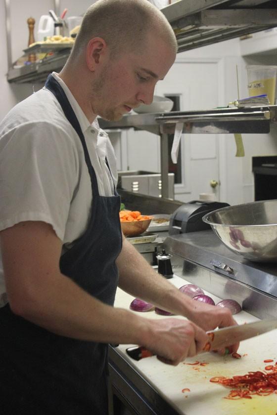Executive sous chef Josh Poletti prepares the shift's family meal. | Nancy Stiles
