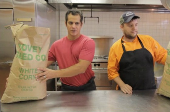 Jason Tilford, left, shows us how these big bags of corn become masa and then tortillas.