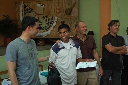 2009 Lo Mejor de Monserrate first place cupping competition farmer Oscar Fernando Medina (center-left), 22, is congratulated by Nicolas Rodrigues of Atlas Coffee (far left), Craig Holt of Atlas Coffee (middle-right), and Juan Manuel Villegas of C.I. RACAFE Coffee Exporters (far right) - COURTESY MIKE MARQUARD