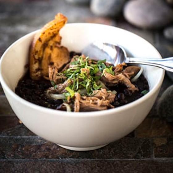 Asada Y Tocino, a stew of black beans with crispy pork belly, seared beef brisket and onions. | Jennifer Silverberg