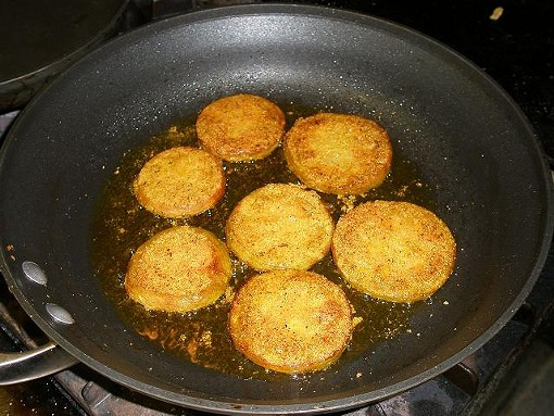 Green tomatoes, frying. - ROBIN WHEELER