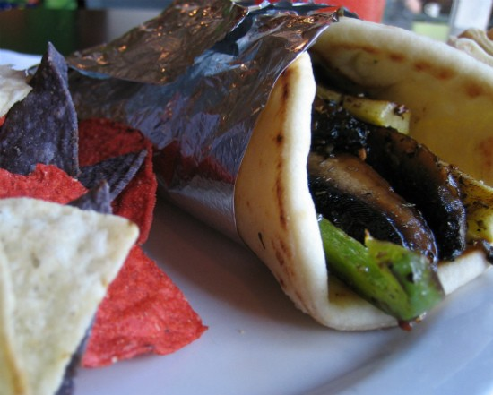 Yellow squash, zucchini, portabella mushrooms, green peppers, onions and feta drizzled with Italian dressing wrapped in pita bread at MoKaBe's. - REASE KIRCHNER