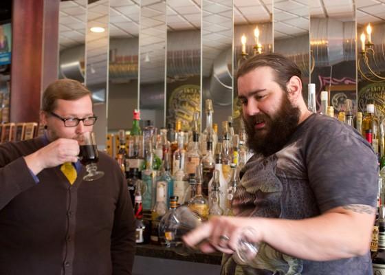 "Tony Saputo, right, shows Jeffrey Moll, Jr. ""behind another man's bar.""   Nancy Stiles"