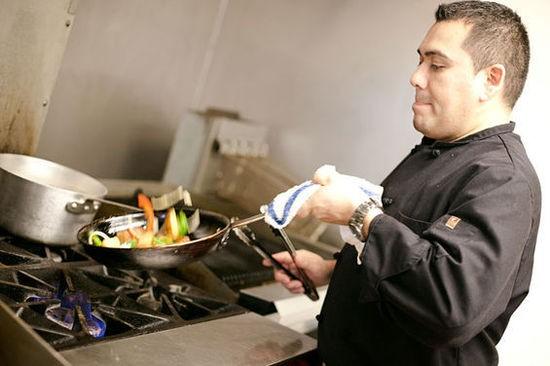Chef Gilberto Espinoza in the Laredo kitchen - CRYSTAL ROLFE