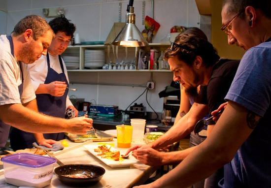 Little Country Gentleman staff, including Mike Randolph (second from left), work on a dish. - MABEL SUEN