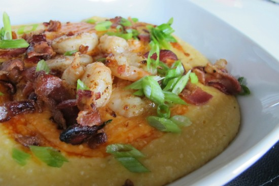 The cheddar grits topped with shrimp and bacon at Soho. - REASE KIRCHNER