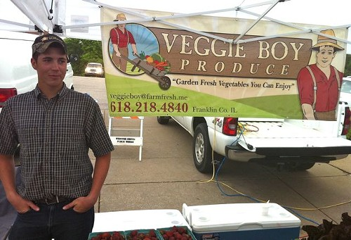 Matthew Kuhns of Veggie Boy Produce stands in a cold drizzle at the Webster Groves Farmers' Market. - HOLLY FANN