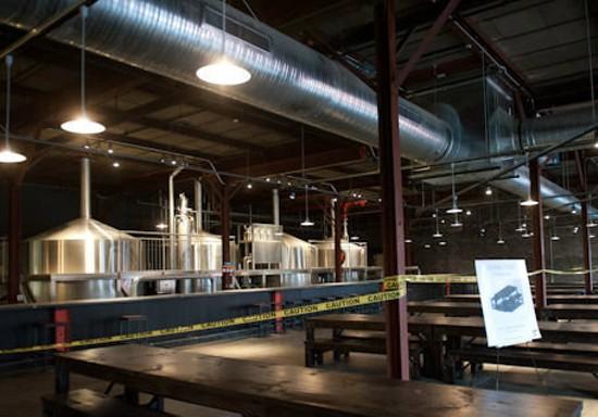 Urban Chestnut's new bar, which wraps around an open brewing area.   Jon Gitchoff