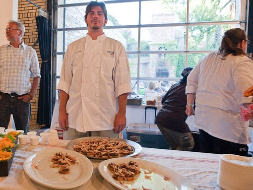 Stephen Kovac of Winslow's Home shows off garlic-rubbed Benne's Best smoked chicken with Winslow's Home and Farm red onion-jalapeño jam on toasted 222 Artisan Bakery baguette. - PHOTO: STEW SMITH