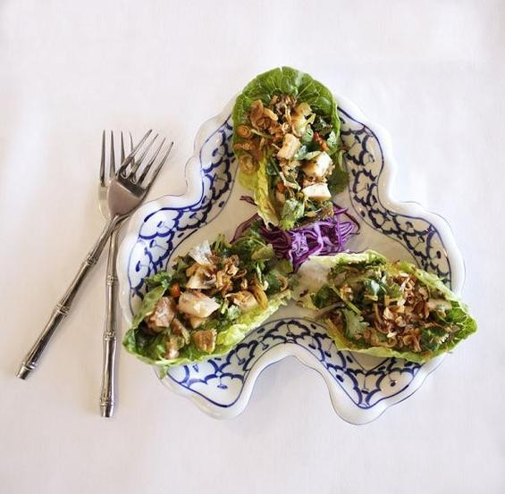 """Miang of Smoked Trout is a """"small snack"""" of flakes of smoked trout, cilanro, shallots and Southeast Asian herbs mixed with a Thai chutney on Bibb leaf lettuce. - JENNIFER SILVERBERG"""